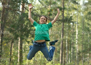 Boy-jumping-in-forest